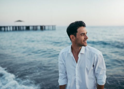 Handsome Happy Man Wearing White Shirt At The Sea Or The Ocean B